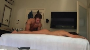 Massuer is stimulating honey's fur pie with dildo after massage